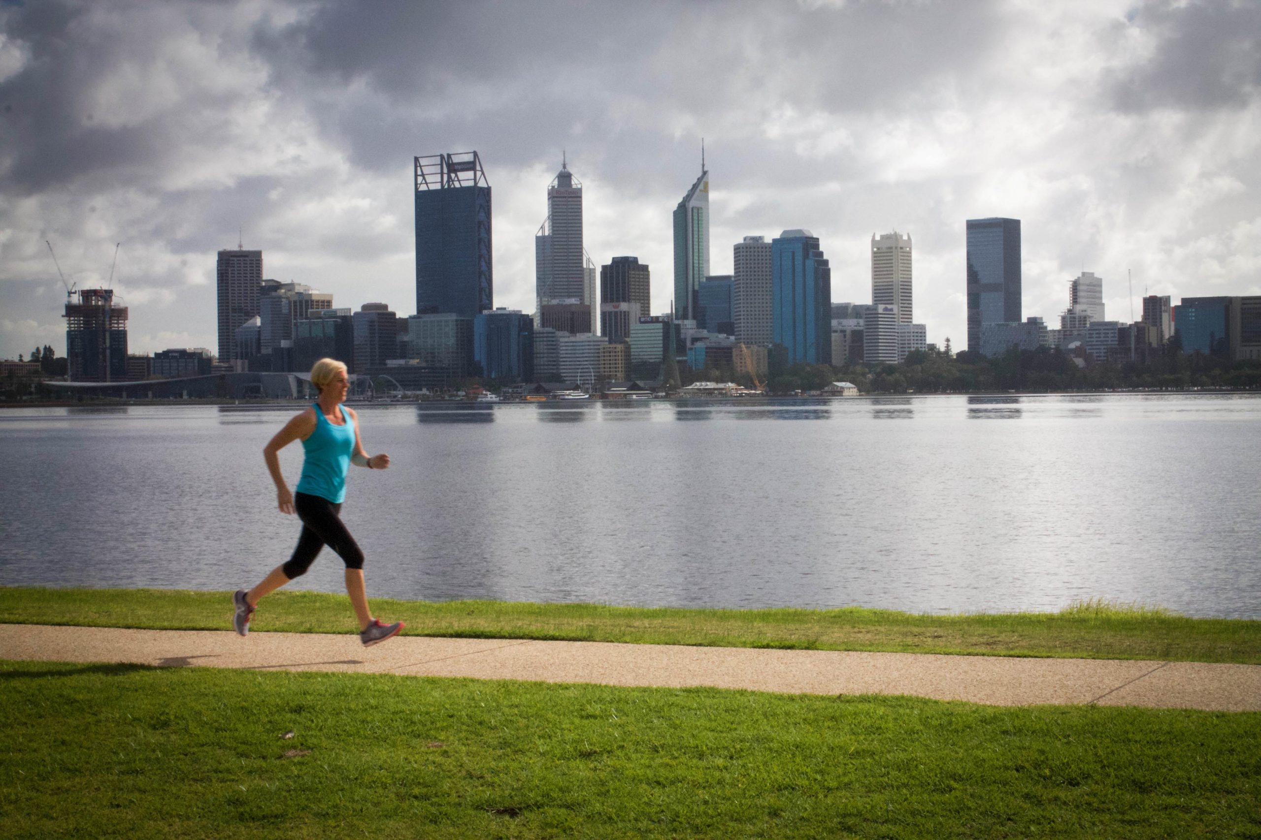 Fiona Murray, Clinical Nutritionist, going on a run in front of Perth city.