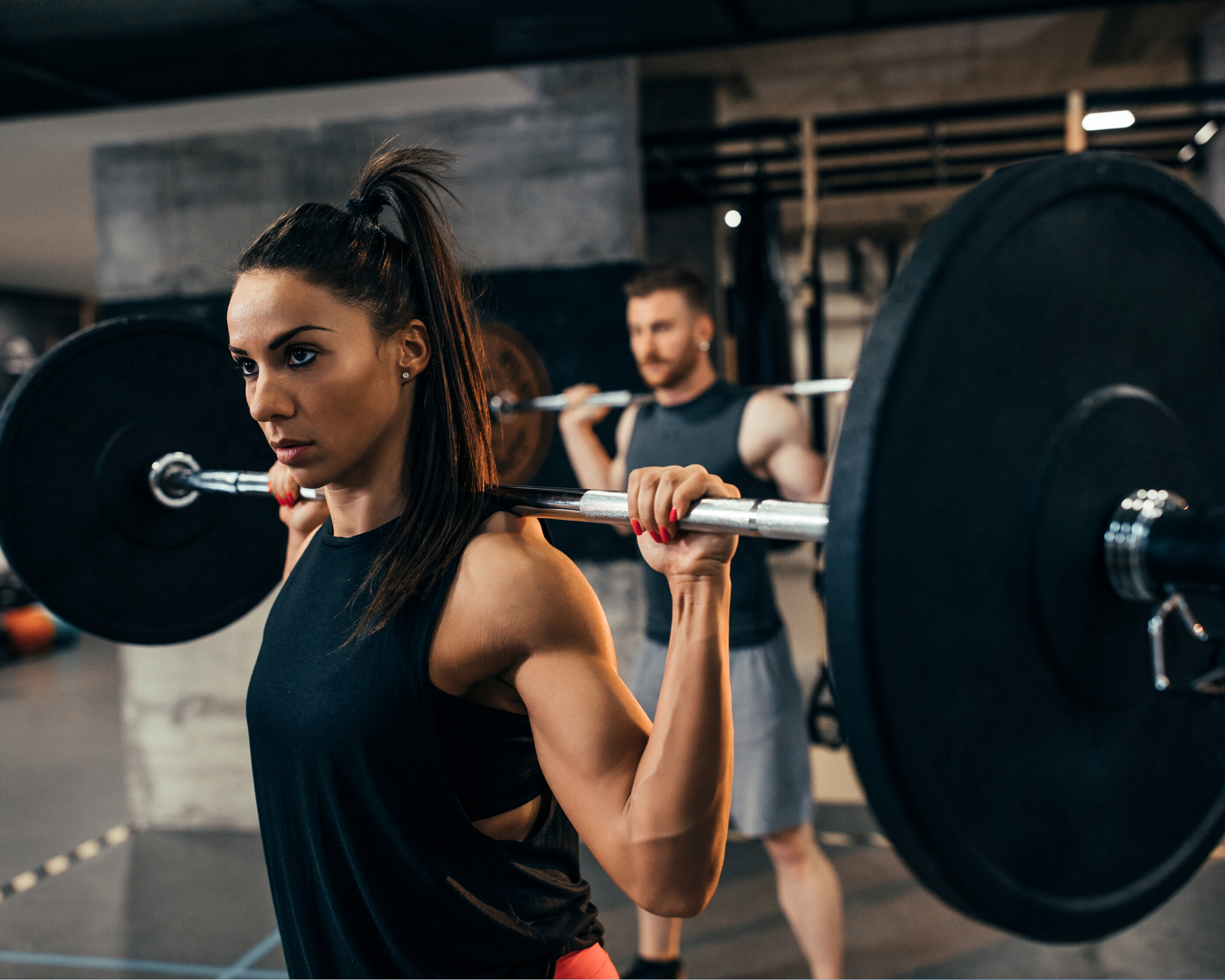 Strong women lifting weights in the gym