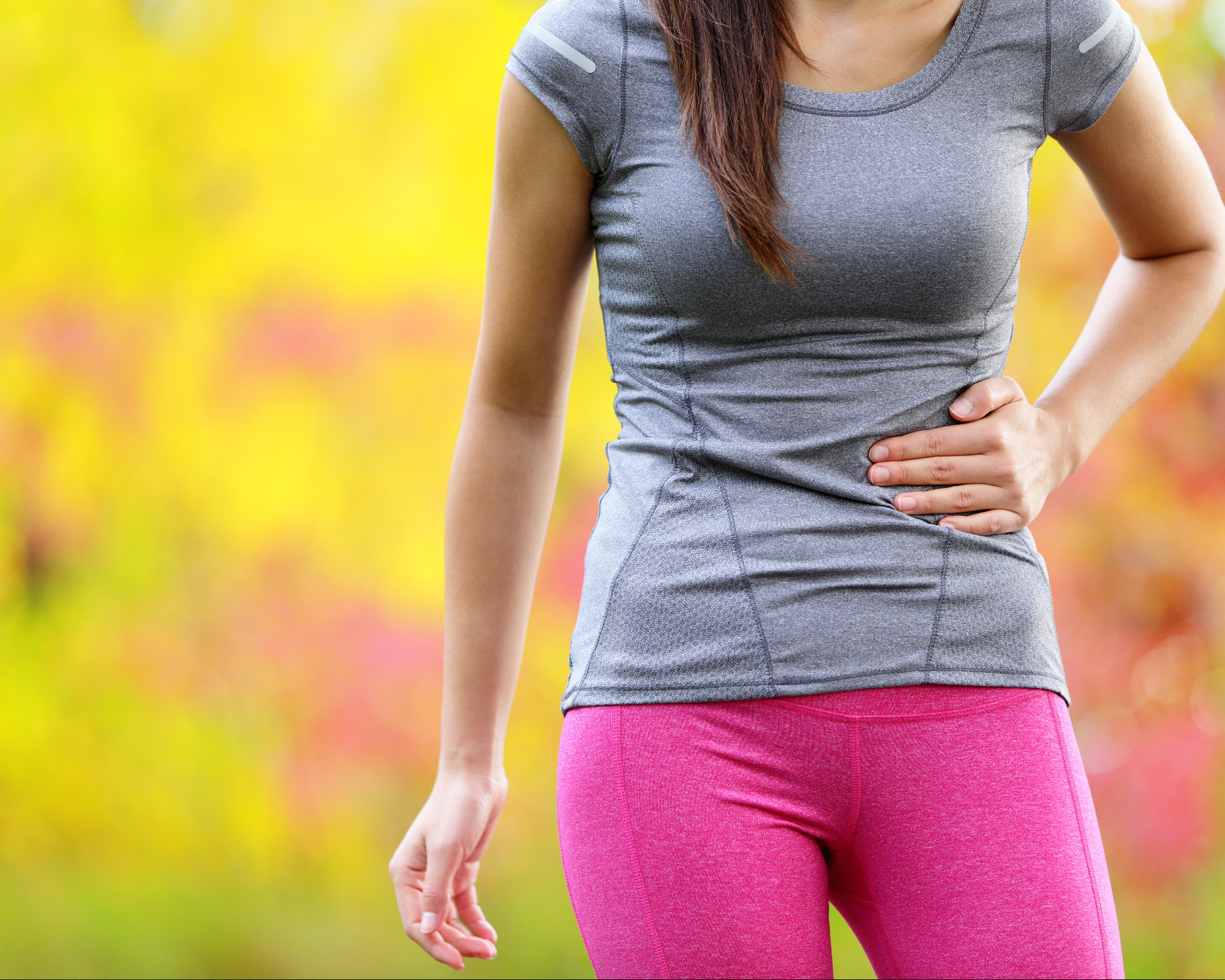 Runner clenching gut in discomfort as they experience runner's gut.
