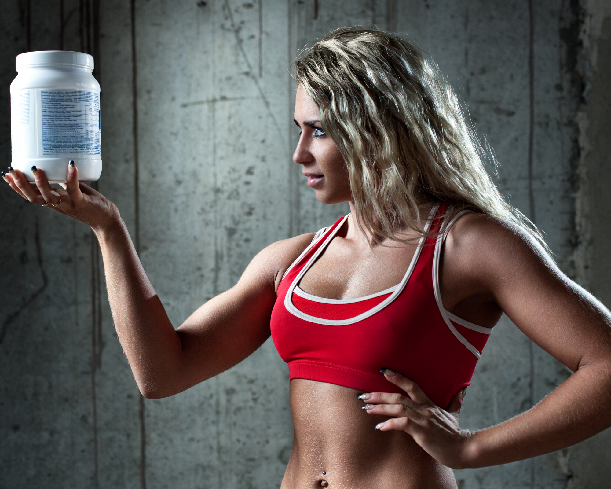Women holding supplements with a sceptical gaze.